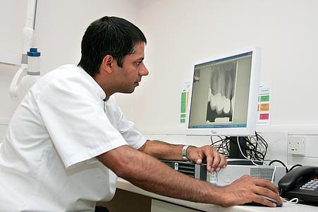Man examining x-ray
